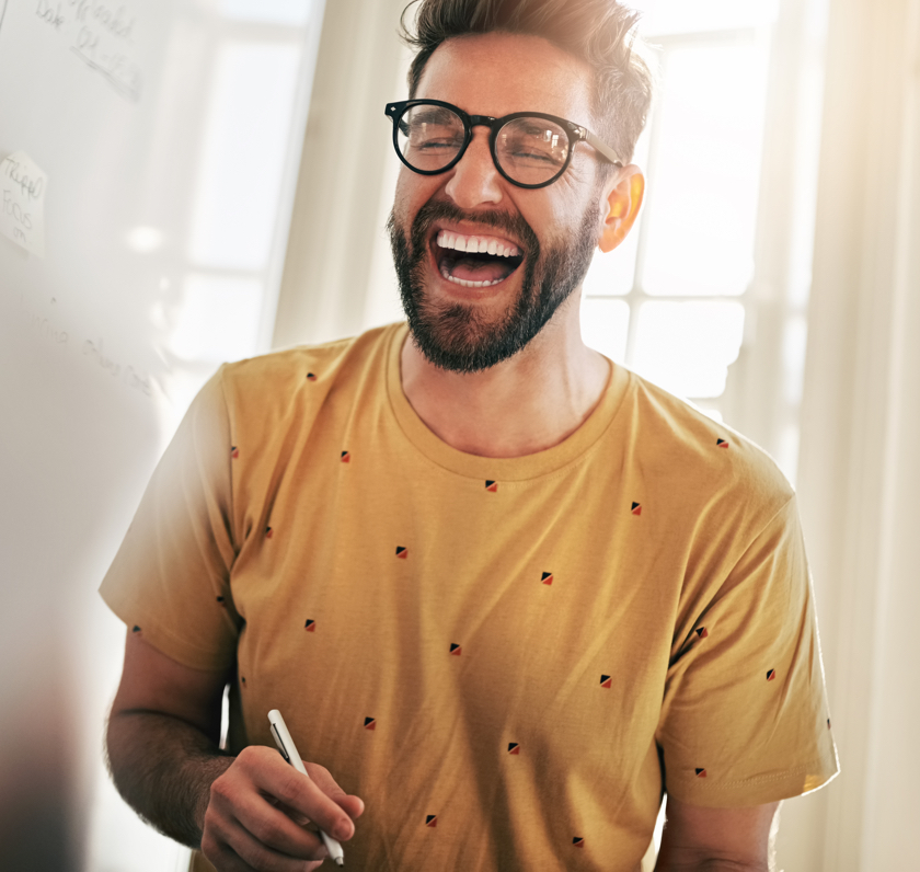 Man with glasses laughing