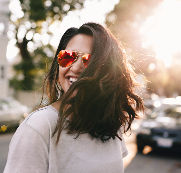 Woman in sunglases smiling